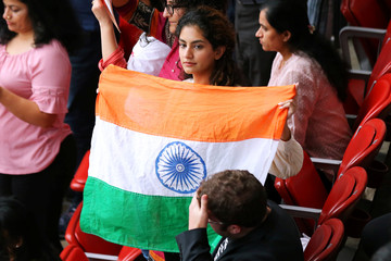 """A woman holds India's flag during a """"Howdy, Modi"""" rally celebrating India's Prime Minister Narendra Modi at NRG Stadium in Houston"""
