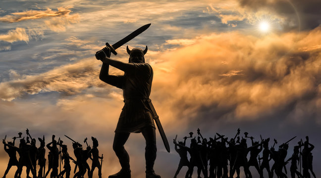 Gigantic figure of enraged God Odin with raised sword and Viking army in Valhalla (plastic toy soldiers), stormy clouds with bright sun, Ragnarok, Old Norse epic, saga, mythology, panoramic image