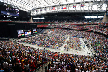 """India's Prime Minister Narendra Modi is introduced during a """"Howdy, Modi"""" rally at NRG Stadium in Houston"""