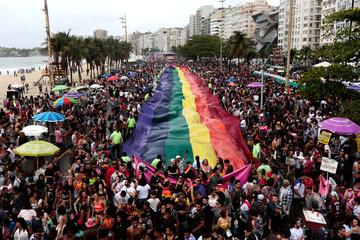 Revellers take part in the Gay Pride Parade at Copacabana beach in Rio de Janeiro