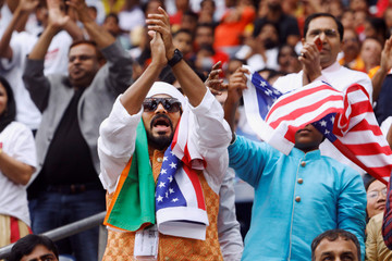 """Supporters react during a """"Howdy, Modi"""" rally celebrating India's Prime Minister Narendra Modi at NRG Stadium in Houston, Texas"""