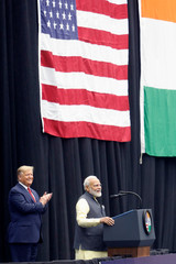 """U.S. President Donald Trump reacts as Indian Prime Minister Narendra Modi speaks during a """"Howdy, Modi"""" rally at NRG Stadium in Houston, Texas"""