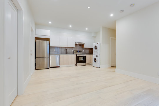 Interior design of a classic living room with kitchen in the newly built house or apartment, basement for rent.