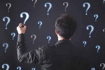 Wall Mural - Businessman with question marks. Problem, Solution