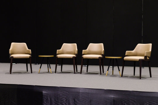 Empty chairs on stage ready for seminar