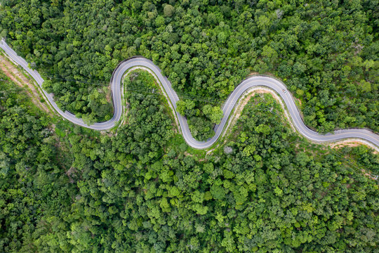 Drone view of curvng road .