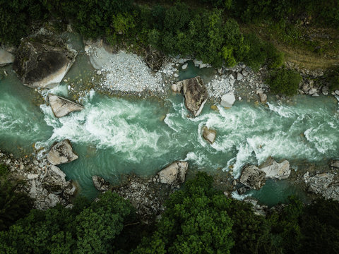 Aerial top view of a splendid mountain river in Swiss Alps
