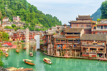 Gorgeous view of wooden tourist boats on the Tuojiang River