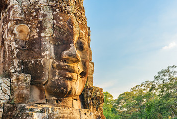 Wall Mural - Awesome view of giant stone face of Bayon temple, Angkor