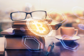 Crypto theme hologram with glasses on the table background. Concept of blockchain. Double exposure.