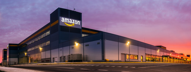 Szczecin, Poland-November 2018: Amazon Logistics Center in Szczecin, Poland in the light of the rising sun,panorama