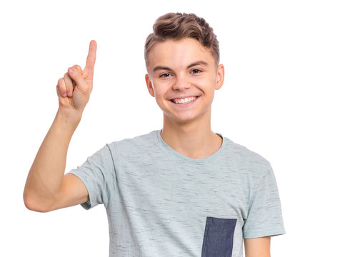 Portrait of happy teen boy showing one palm - 1 finger, isolated on white background. Happy smiling child doing gesture of number One. Series of photos count from 1 to 10.