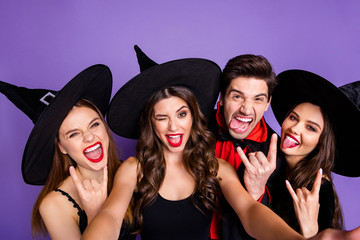 Close up photo of fun funny funky dark creatures rock-and-roll witches sorcerer enjoy october halloween party event show horned sign symbol make v-signs isolated over violet purple color background