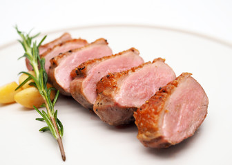 Grilled duck breast slices, with rosemary