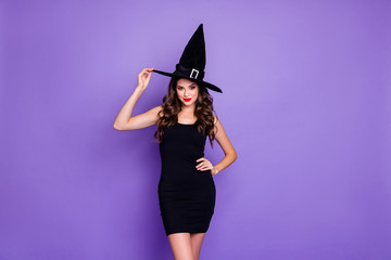 Trick-or-treat. Portrait of charming woman witch gothic creepy fantasy creature of darkness want...