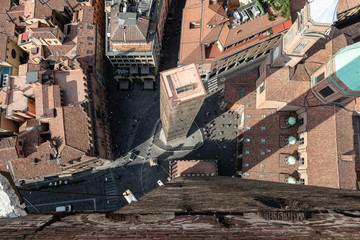 View from atop Asinelli Tower looking down upon Garisenda Tower. Better know as the Two Towers of Bologna. Italy.