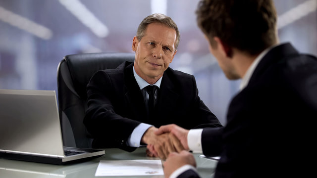 Displeased hirer shaking hand to candidate, bad job interview result concept