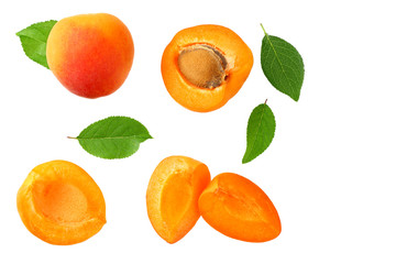 apricot fruits with slices and green leaf isolated on white background. top view