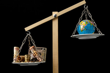 Earth and Money on a Two Pan Balance Wall mural