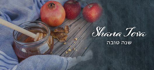 Jewish National Holiday. Rosh Hashana with honey, apple and pomegranate on wooden table. Text: Shana Tova