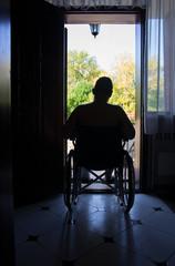 Sad man in worn wheelchair