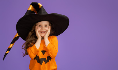 little witch on purple background Wall mural
