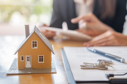 Saving money to invest in house or property in the future. Business Finance Concept.