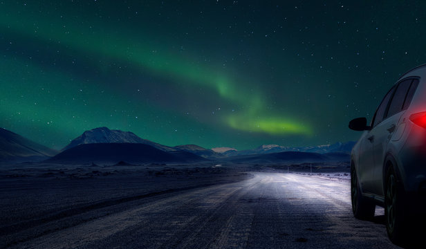 car by night on gravel  road of iceland
