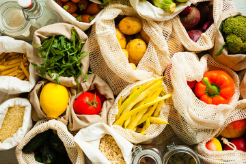 Top view of fresh vegetables in eco mesh bags