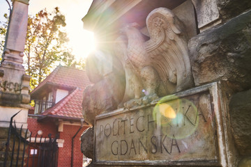 Entrance of Gdansk University of Technology in Poland with words Politechnika Gdanska meaning this higher educational institutiton's name in Polish with the eagle emblem on a sunny day