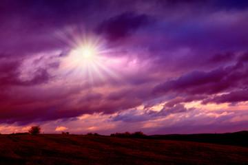 Beautiful sunset landscape with lilac sky and dramatik clouds Nature landscape.