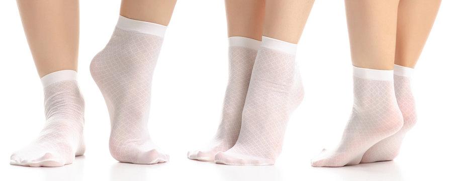 Set female legs in white nylon socks on white background isolation