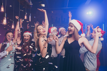 Canvas Prints Bar Portrait of nice attractive stylish cheerful cheery positive glad dreamy ladies and guy having fun time dream rest relax celebratory flying decorative elements at modern luxury fogged lights nightclub