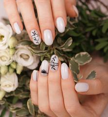 Poster de jardin Manicure Gentle neat manicure on female hands on flowers background. Nail design