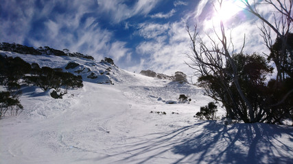 Beautiful day in the snow, on the mountains, blue skies