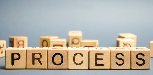 Wooden blocks with the word Process. Business management concept. Litigation and technological processes.