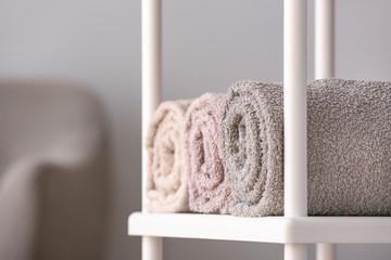 Clean towels on shelf in room