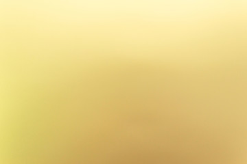 Golden, yellow metal background, free space for an inscription.