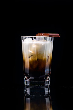 classic white Russian cocktail with reflection on a dark background