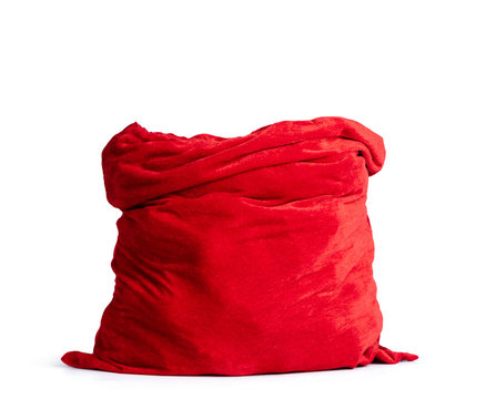 Santa Claus open red bag full, isolated on white background. File contains a path to isolation.