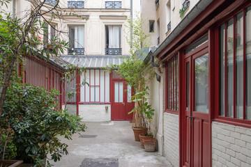 Paris, attractive houses in a parisian co-ownership in the Marais, charming ancient courtyard Wall mural