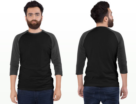 Bearded male model wearing white and grey 3/4 sleeve raglan shirt in dark blue denim jeans pant. isolated background