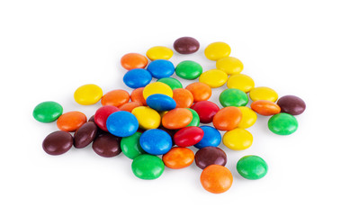 Round multi-colored sweets on a white background