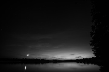 Night sky over the lake, black and white image