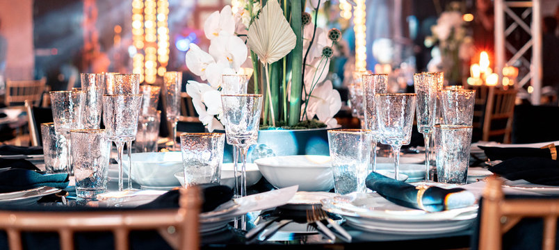 Luxury catering. Wedding or anniversary. Banquet. table served with cutlery, flowers, crockery.