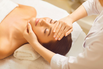Facial massage to a beautiful girl in a beauty clinic.