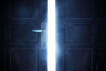 Open door with bright light, halloween theme