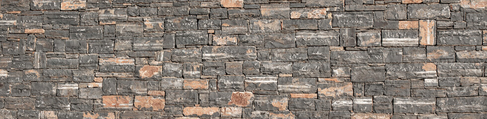 HD Texture of a stone. Old stone wall texture background. Grey stone wall as a background or texture. Stone wall of natural stones in different sizes. Side covering with natural stones. High quality.