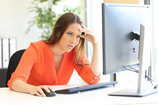 Worried entrepreneur checking computer content