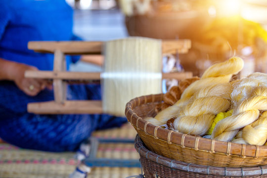 The golden thread from the silk Is a handicraft weaving work